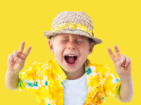 Child in yellow hawaiian shirt and straw hat shouts loud of the beginning of holidays, vacation, fun. Isolated yellow. Concept of summer